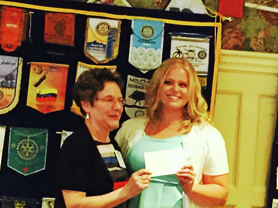 Middletown High School junior Anna Grygorowicz accepts her Service Above Self Award from Lois Muraro of the Middletown Rotary Club. The teen performed over 200 hours of service to the Capuchin Youth and Family Services. Photo: Courtesy Middletown High School
