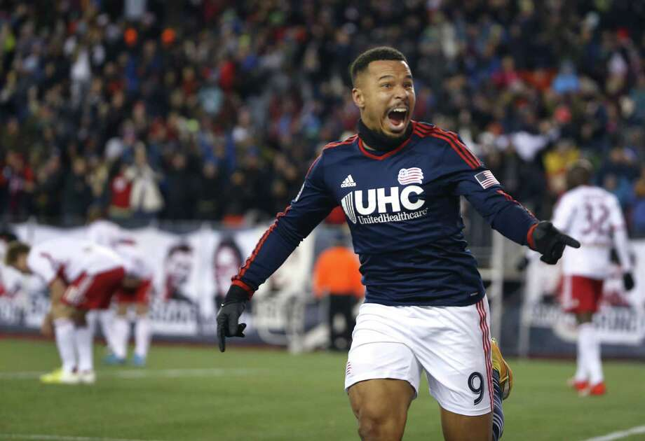 New England Revolution's Charlie Davies celebrates his goal against the New York Red Bulls during the second half of the MLS Eastern Conference final on Saturday in Foxborough, Mass. The match ended 2-2 and New England advances to the MLS Cup with a two-game aggregate 4-3. Photo: Elise Amendola — The Associated Press  / AP