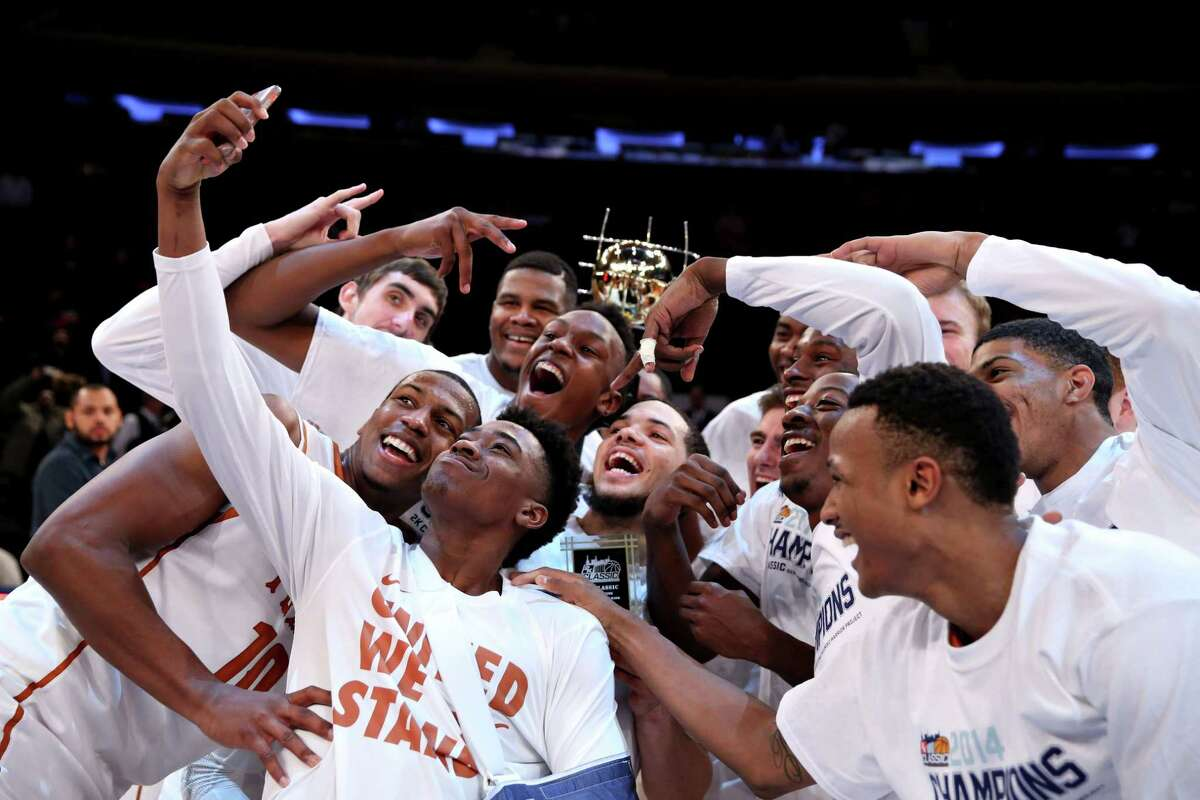 Texas players celebrate with the 2K Classic championship trophy after beating California at Madison Square Garden in New York on Nov. 21. The Longhorns will be in Gampel Pavilion today to take on 24th-ranked UConn.