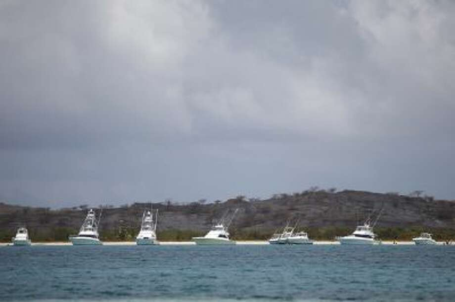 Yachts sit anchored off a beach in what was once a U.S. Naval Training Range on Vieques Island off Puerto Rico.