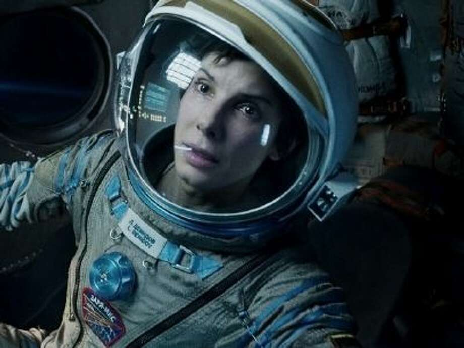"""This film image released by Warner Bros. Pictures shows Sandra Bullock in a scene from """"Gravity."""""""