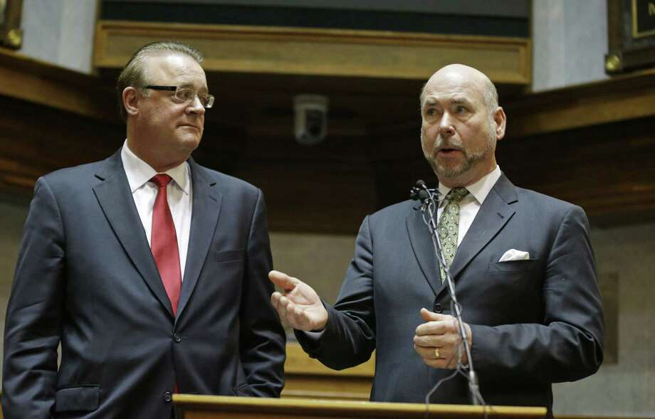 Indiana Senate President Pro Tem David Long, left, (R-Fort Wayne) and House Speaker Brian C. Bosma (R-Indianapolis) discuss their plans for clarifying the Indiana Religious Freedom Restoration Act during a press conference at the Statehouse in Indianapolis, Monday, March 30, 2015. Republican legislative leaders in Indiana state say they are working on adding language to a new state law to make it clear that it doesn't allow discrimination against gays and lesbians.  (AP Photo/Michael Conroy) Photo: AP / AP