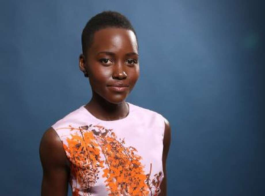 In this Monday, Feb. 10, 2014 file photo, Lupita Nyong'o poses for a portrait at the 86th Oscars Nominees Luncheon, in Beverly Hills, Calif.
