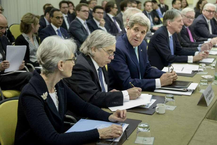 U.S. Secretary of State John Kerry, third left, chats with U.S. Under Secretary for Political Affairs Wendy Sherman, as U.S. Secretary of Energy Ernest Moniz, second right, takes a note while waiting for the start of a meeting on Iran's nuclear program with other officials from Britain, China, France, Germany, Russia, the European Union and Iran at the Beau Rivage Palace Hotel in Lausanne, Switzerland on March 31, 2015. Photo: AP Photo/Brendan Smialowski, Pool  / POOL AFP