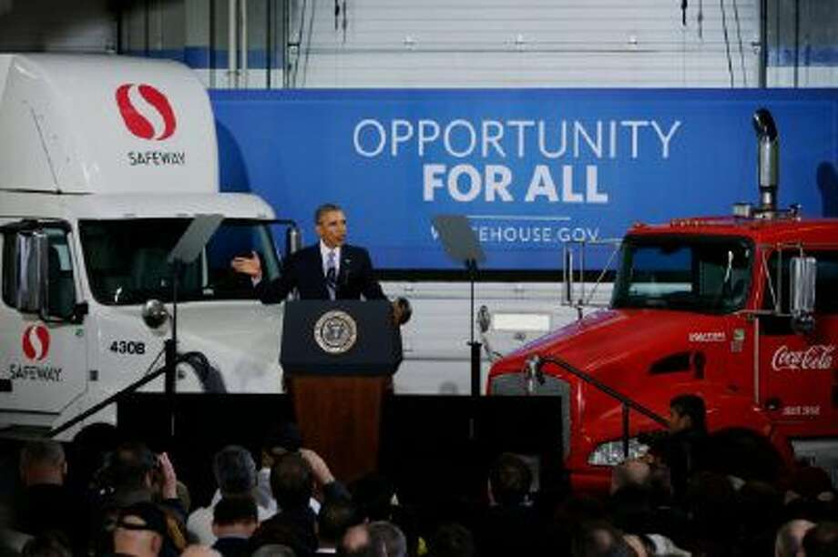 President Barack Obama speaks at a distribution center for Safeway stores in Upper Marlboro, Md. Feb. 18, 2014. The president said having a more fuel-efficient truck fleet will boost the economy and help combat climate change.