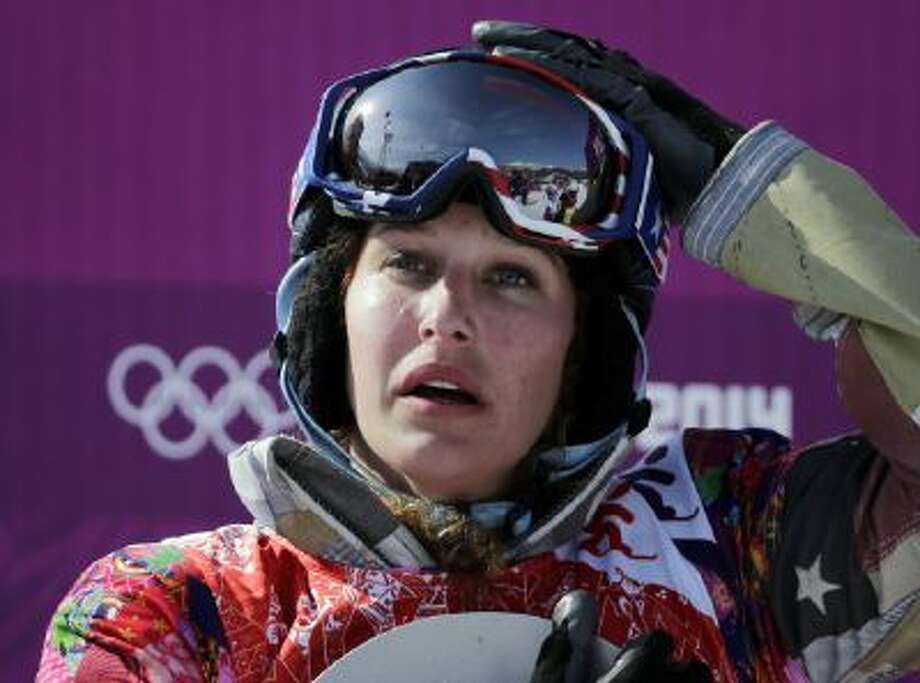Lindsey Jacobellis of the United States reacts after winning the small final of the women's snowboard cross at the Rosa Khutor Extreme Park, at the 2014 Winter Olympics, Sunday, Feb. 16, 2014, in Krasnaya Polyana, Russia.