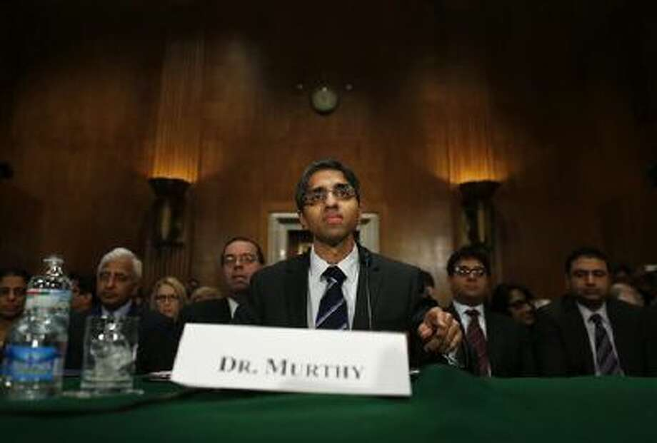 Dr. Vivek Hallegere Murthy, President Barack Obama's nominee to be the next U.S. Surgeon General, prepares to testify Feb. 4 before the Senate Health, Education, Labor, and Pensions (HELP) Committee hearing on his nomination. Photo: AP / AP