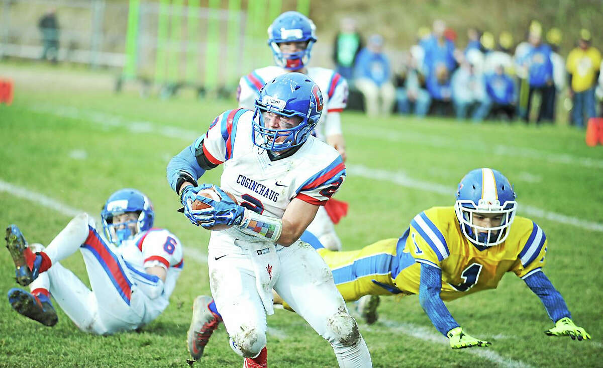 Jimmy Zanor - Middletown Press Cognchaug senior Cam Powers intercepts a pass intended for Gilbert's Billy Komons Thursday at Van Why Field.