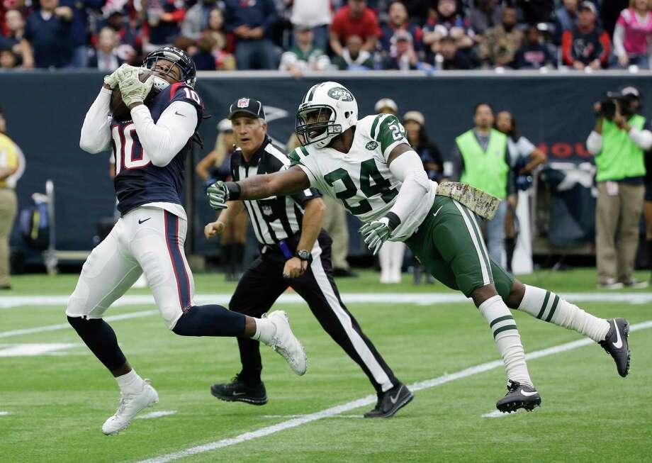 Texans receiver DeAndre Hopkins burns Jets cornerback Darrelle Revis for a touchdown on Sunday in Houston. Photo: David J. Phillip — The Associated Press  / AP
