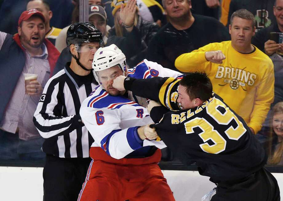 The Rangers' Dylan McIlrath (6) and Bruins' Matt Beleskey fight during the second period of Boston's 4-3 win on Friday. Photo: Michael Dwyer — The Associated Press  / AP