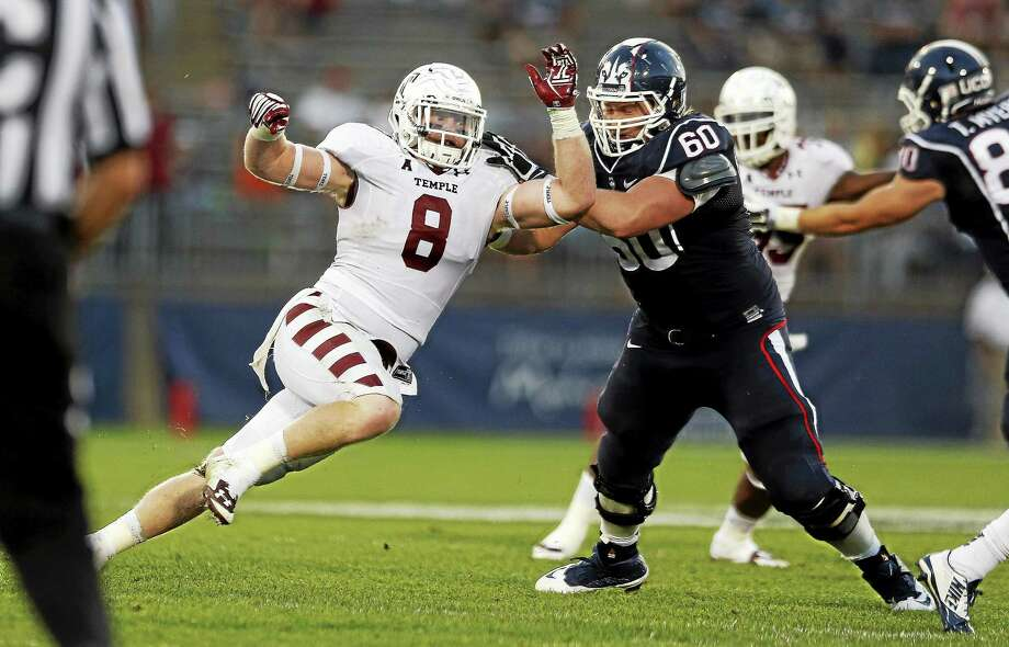 UConn guard Tyler Samra blocks Temple linebacker and St. Joseph grad Tyler Matakevich during a Sept. 27 game at Rentschler Field in East Hartford. Photo: Michael Dwyer — The Associated Press File Photo  / AP