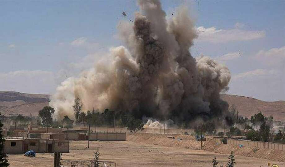FILE - This photo released on Saturday, May 30, 2015 by a militant website, which has been verified and is consistent with other AP reporting, shows Tadmur prison, blown up and destroyed by the Islamic State group in Palmyra (Tadmur in Arabic), Homs province, Syria. The prison was where government opponents were held, and reports over the years said it was the site of beatings and torture. (Militant website via AP, File) Photo: AP / Militant website