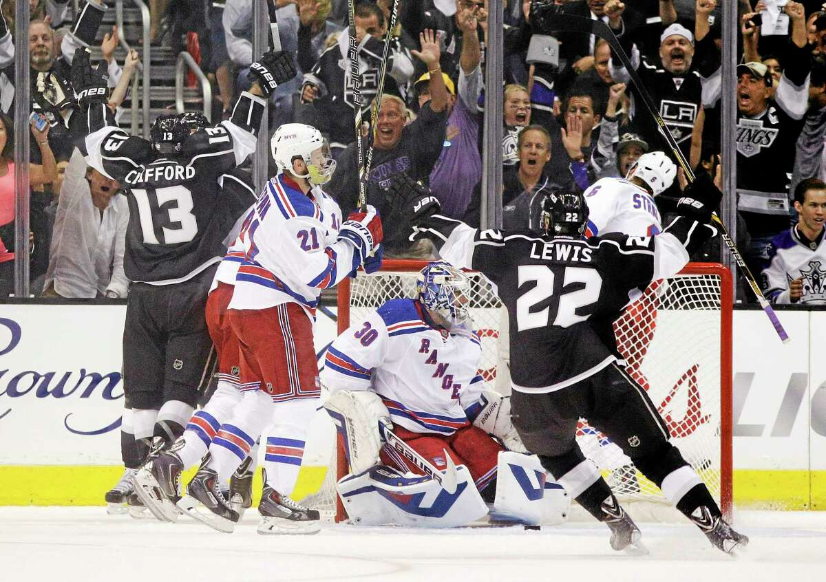 Los Angeles Kings left wing Kyle Clifford (13) and Trevor Lewis (22) celebrate a goal by Clifford during the first period of Game 1 in the NHL Stanley Cup Final hockey series against the New York Rangers on Wednesday in Los Angeles.