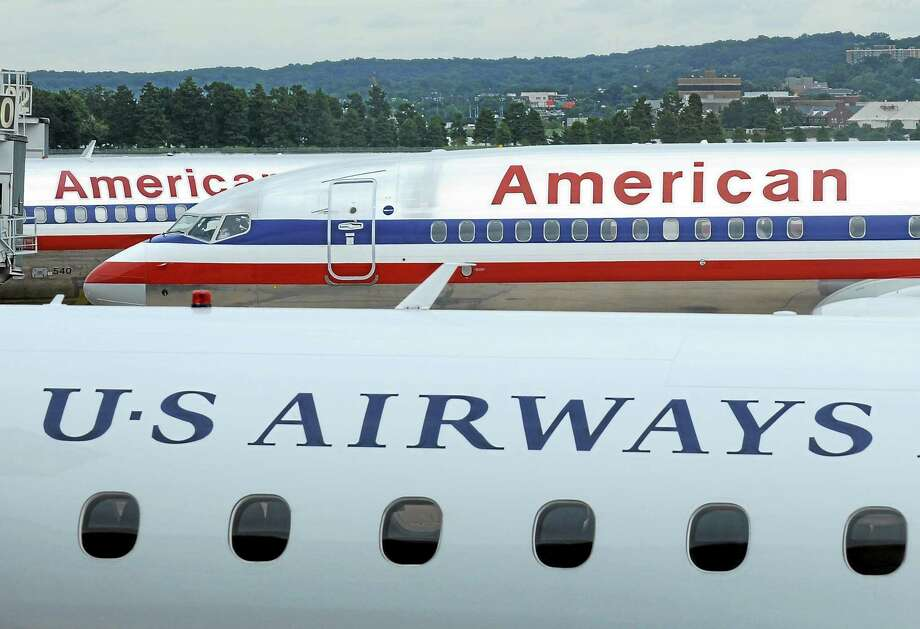 American Airlines planes and a US Airways plane at parked at Washington's Reagan National Airport. Photo: AP Photo/Susan Walsh  / AP2013