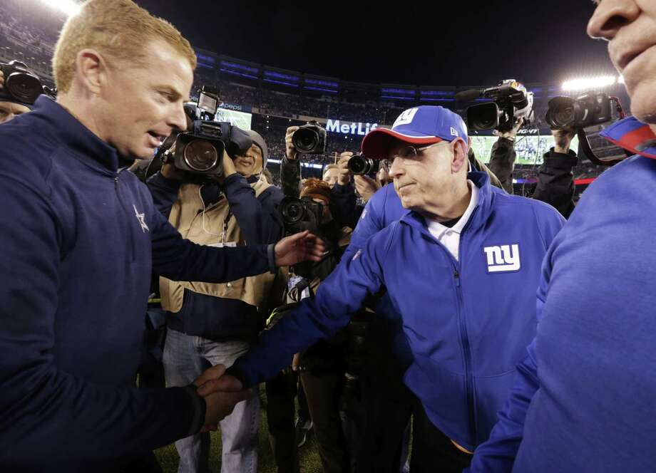 Dallas head coach Jason Garrett, left, greets New York Giants head coach Tom Coughlin after the Cowboys' 31-28 win on Sunday in East Rutherford, N.J. Photo: Julio Cortez — The Associated Press  / AP