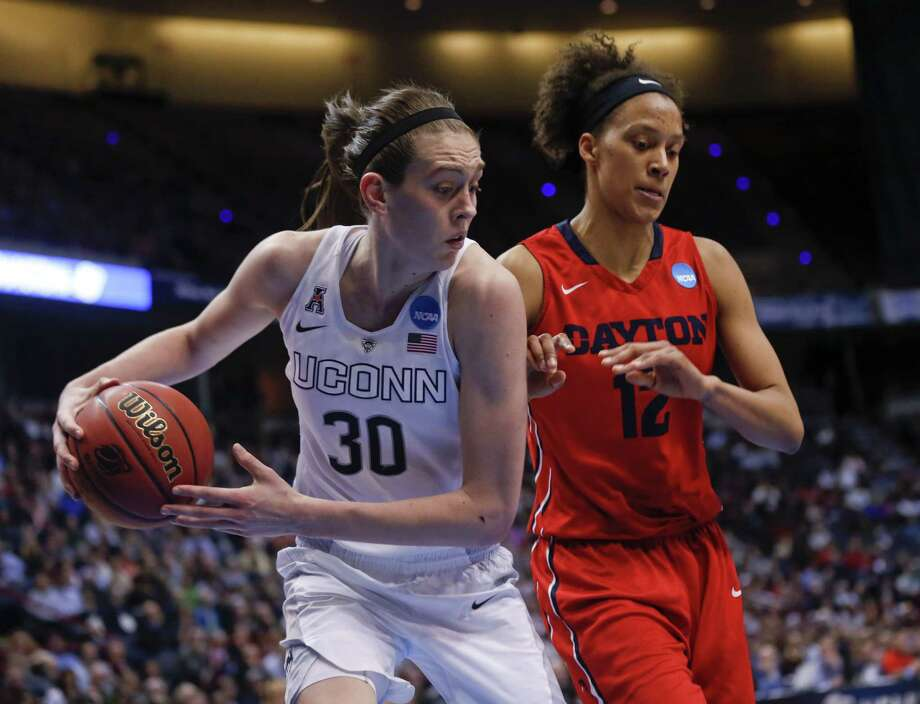 Connecticut forward Breanna Stewart (30) grabs a rebound in front of Dayton center Jodie Cornelie-Sigmundova, of France, during the second half of a regional final game in the NCAA women's college basketball tournament Monday, March 30, 2015, in Albany, N.Y. (AP Photo/Mike Groll) Photo: AP / AP