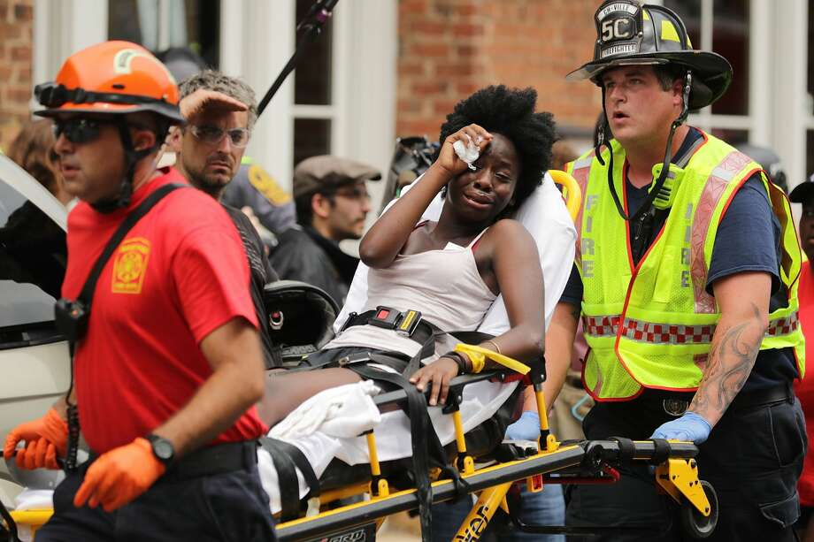 Rescue workers move victims on stretchers after car plowed through a crowd of counter-demonstrators marching through the downtown shopping district August 12, 2017 in Charlottesville, Virginia. A state official said that the driver of the car is in custody. Photo: Chip Somodevilla/Getty Images