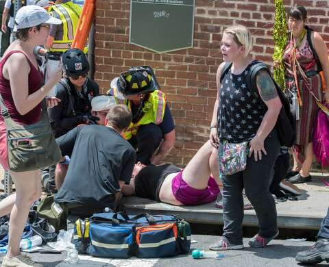 Video shows car plowing into protesters during white power