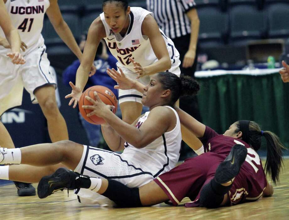 UConn's Kaleena Mosqueda-Lewis steals the ball from College of Charleston's Jackie Luna-Castro during the No. 3 Huskies' 85-24 win on Friday in Estero, Fla. Photo: Jack Hardman — The News-Press  / The News-Press
