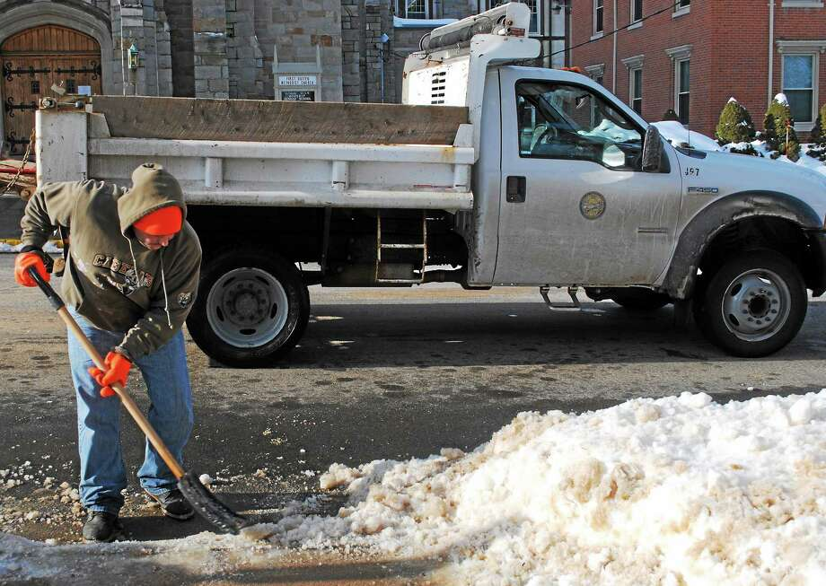 Viktoria Sundqvist - The Middletown Press ¬ Louis Frangione, who works for the city's Parks and Public Works Department, shovels part of a walkway on the South Green in Middletown. Photo: Journal Register Co.