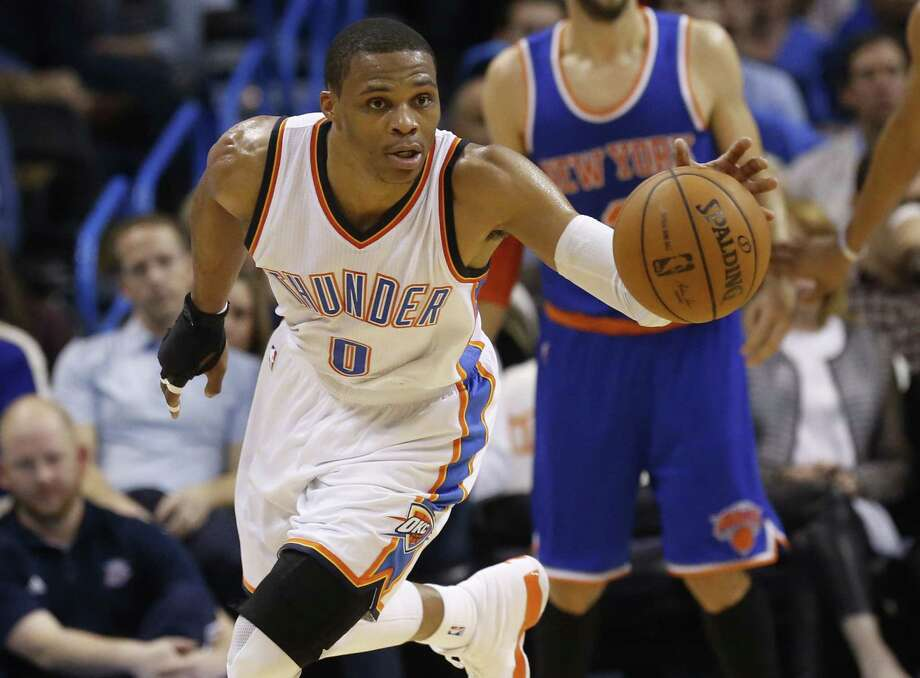 Oklahoma City guard Russell Westbrook heads upcourt after a steal in the third quarter of the Thunder's 105-78 win over the New York Knicks in Oklahoma City. Photo: Sue Ogrocki — The Associated Press  / AP