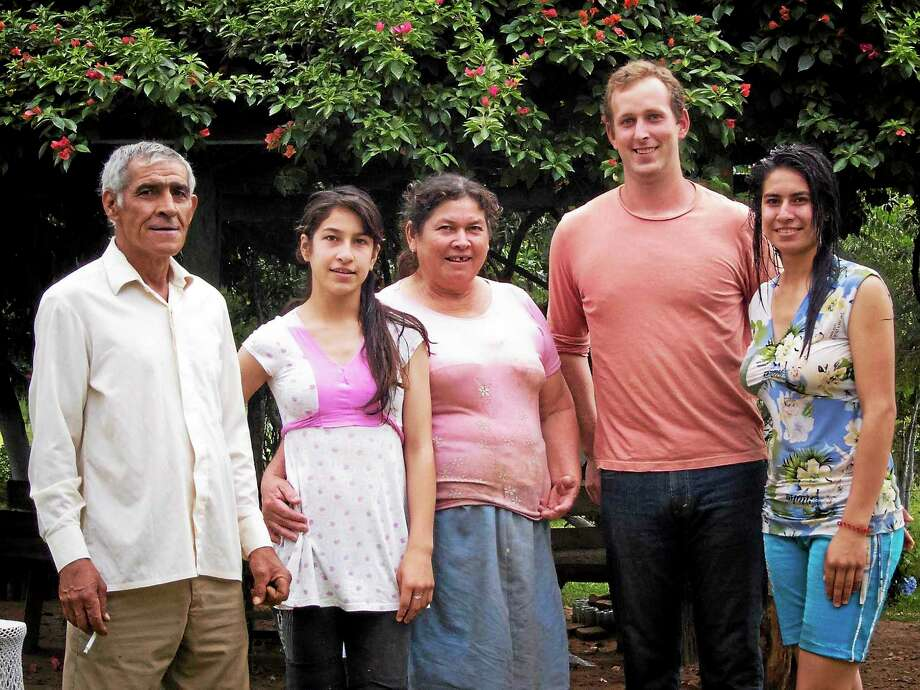 Submitted photo Wesleyan alumnus and returned Peace Corps volunteer Baker Woods with his host family. Photo: Journal Register Co.