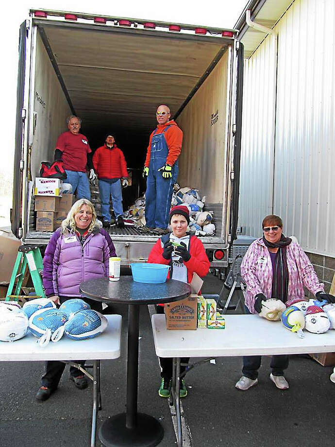 Volunteers from the Middletown Community Thanksgiving Project distributed turkeys this week. Pictured, front row, from left are Gabriele Nyenhuis, Marcus Santamaria, and Helen Roy; in the truck, from left, are Rodney Roy, Steve Koller and Roy J. Cooper. Photo: Courtesy Photo