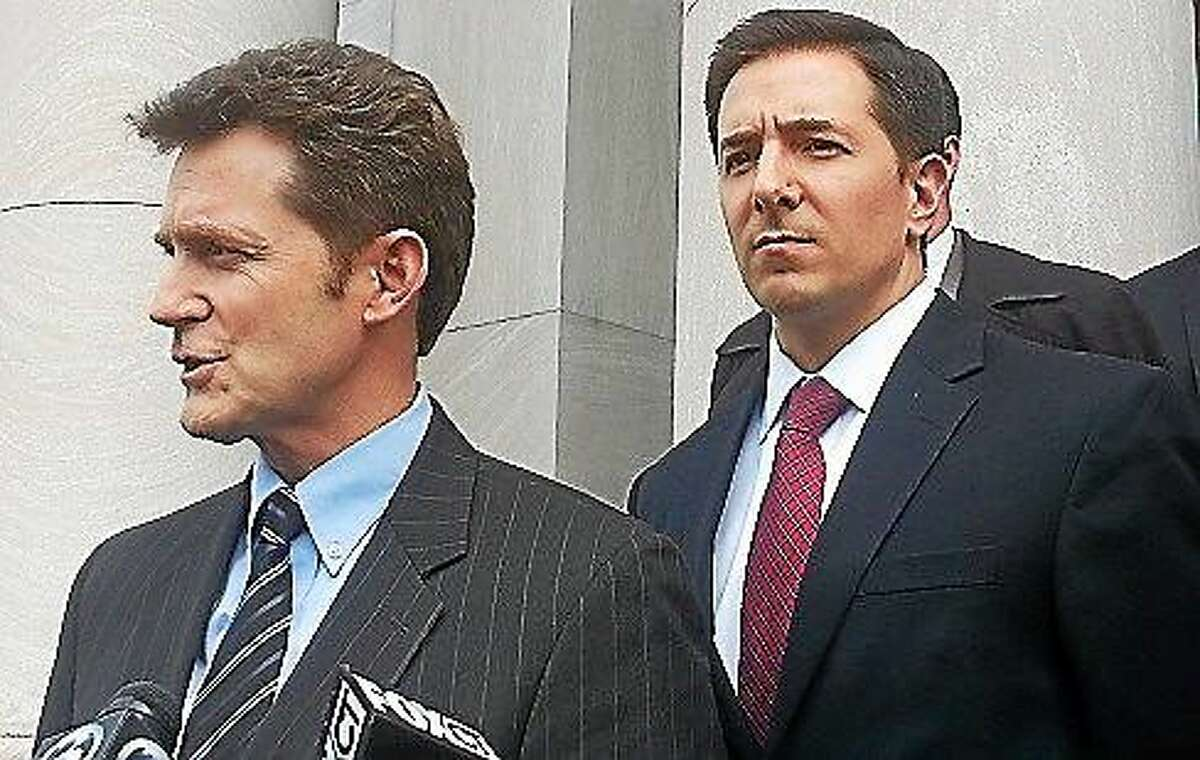 First Assistant U.S. Attorney Michael J. Gustafson and Financial Fraud and Public Corruption Unit Chief Christopher M. Mattei stand on the steps of U.S. District Court in New Haven following the sentencing of former congressional candidate Lisa Wilson-Foley.