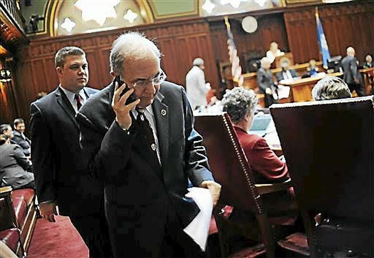 (AP Photo/Jessica Hill) Connecticut State Senate President Martin Looney takes a phone call in Senate Chambers at the Capitol on the final day of session, Wednesday, June 3, 2015, in Hartford, Conn.