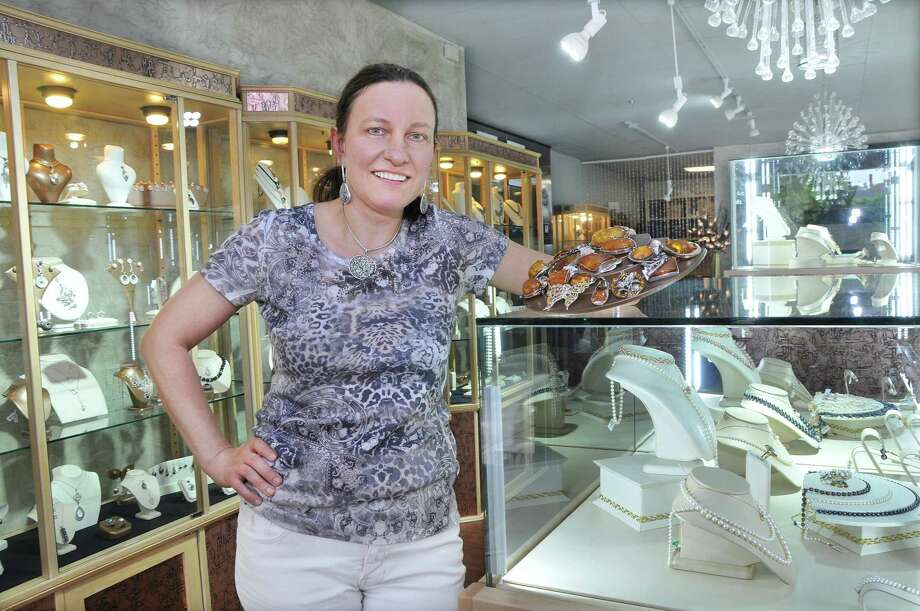 Mira Alicki, owner of Mira Jewelry Design at 476 Main St. in Middletown will hold a grand re-opening on June 13 at 5 p.m. after an extensive redesign of her store after 19 years in business. Photo: Catherine Avalone — The Middletown Press  / TheMiddletownPress