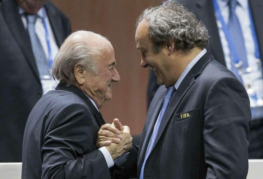 FIFA president Sepp Blatter, left, says he will resign. Photo: Patrick B. Kraemer — The Associated Press  / KEYSTONE