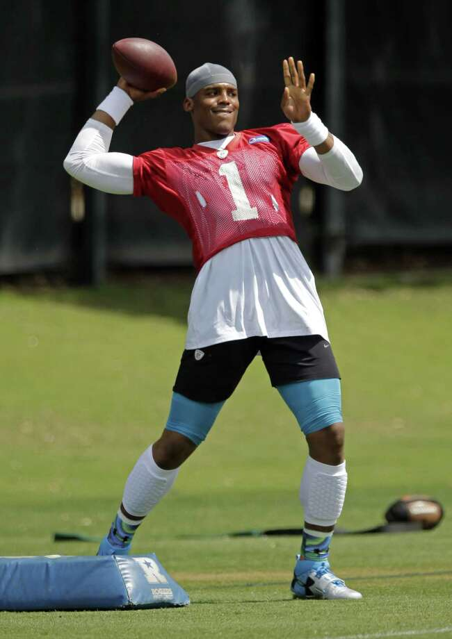 Carolina Panthers quarterback Cam Newton throws a pass during practice Thursday in Charlotte, N.C. Photo: Chuck Burton — The Associated Press  / AP