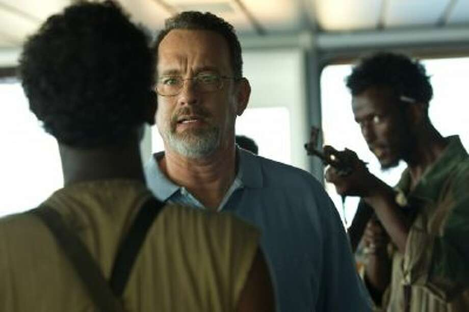 "This film image released by Sony - Columbia Pictures shows Tom Hanks, center, in a scene from ""Captain Phillips."""