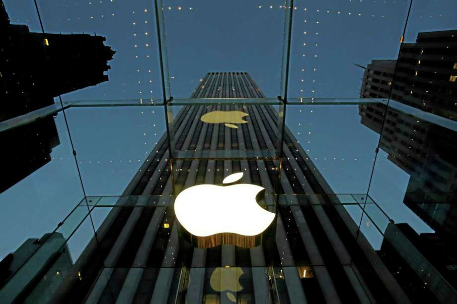 FILE - In this Nov. 20, 2013, file photo, the Apple logo is illuminated in the entrance to the Fifth Avenue Apple store, in New York. Photo:  (Mark Lennihan — The Associated Press) / AP