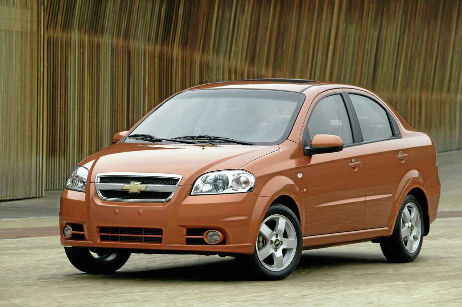 This undated file photo provided by General Motors shows the 2007 Chevrolet Aveo LT. General Motors on Wednesday, May 21, 2014 recalled 218,000 Chevrolet Aveo subcompact cars, model years 2004 through 2008. The daytime running light module in the dashboard center stack can overheat, melt and catch fire. (AP Photo/General Motors) Photo: AP / General Motors