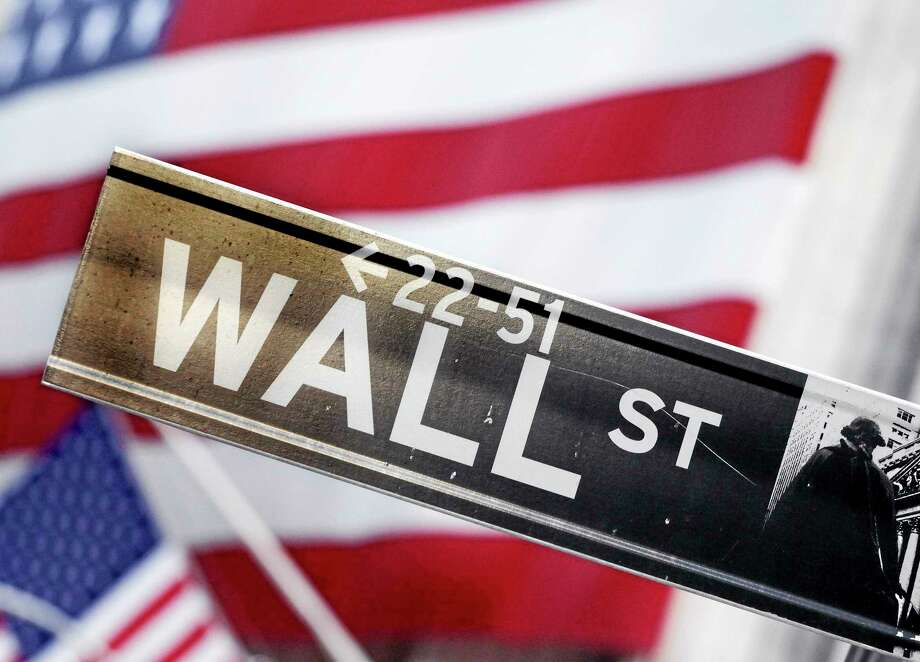 This Aug. 9, 2011, photo shows a Wall Street street sign near the New York Stock Exchange, in New York. U.S. stock futures are heading lower in early trading Tuesday, June 3, 2014, a day after major indexes reached new highs. (AP Photo/Mark Lennihan, File) Photo: AP / AP