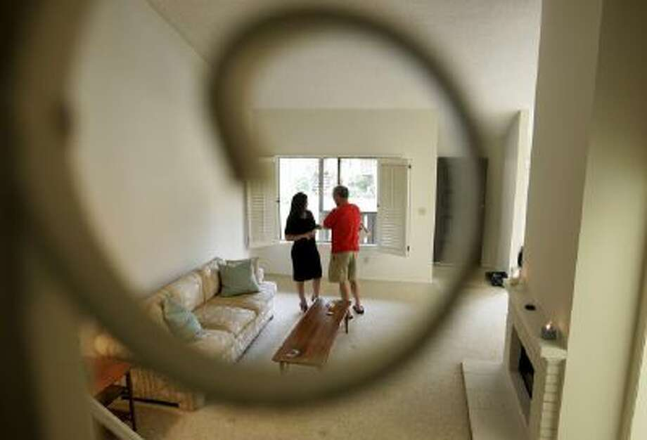 Gina Labellarti, a realtor with Coldwell Banker Dynasty TC, left, speaks with a potential homebuyer during an open house in Arcadia, Calif.