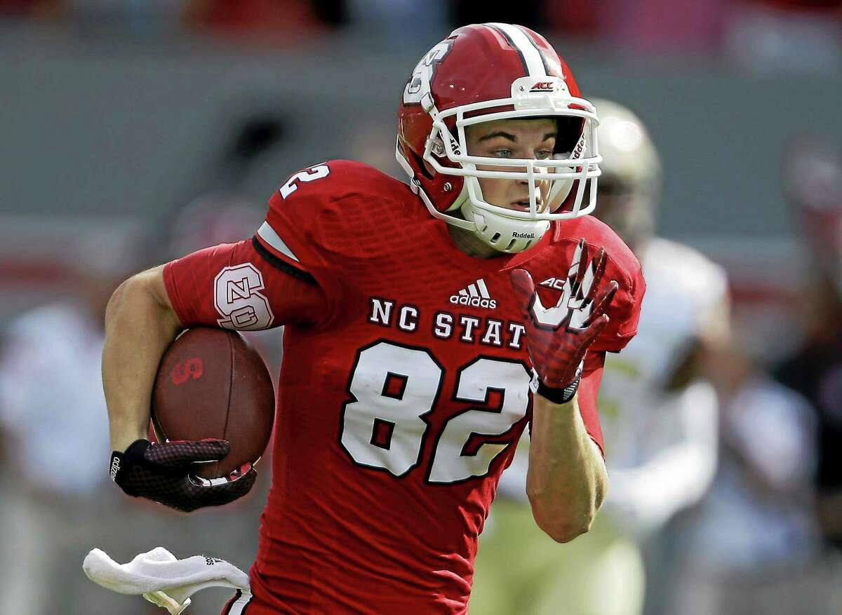 Bo Hines runs for a touchdown against Florida State during a Sept. 27, 2014 game in Raleigh, N.C.