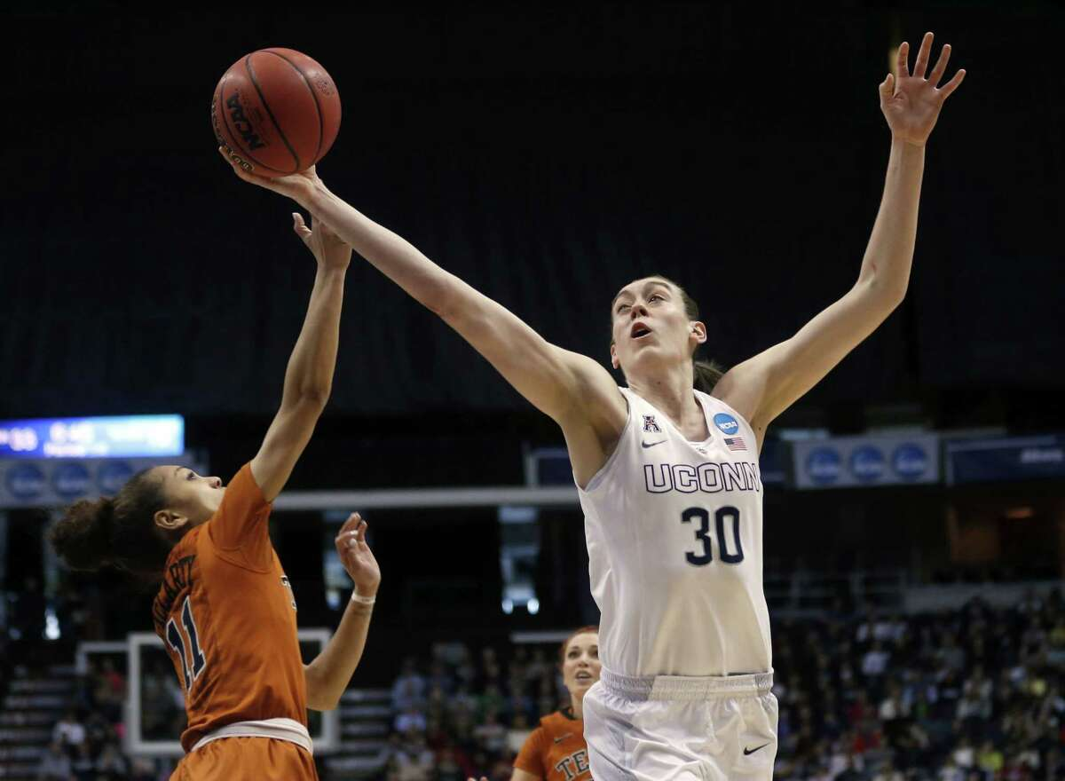 UConn's Breanna Stewart grabs a rebound over Texas' Brooke McCarty during the first half of the Huskies' 105-54 win Saturday in Albany, N.Y.