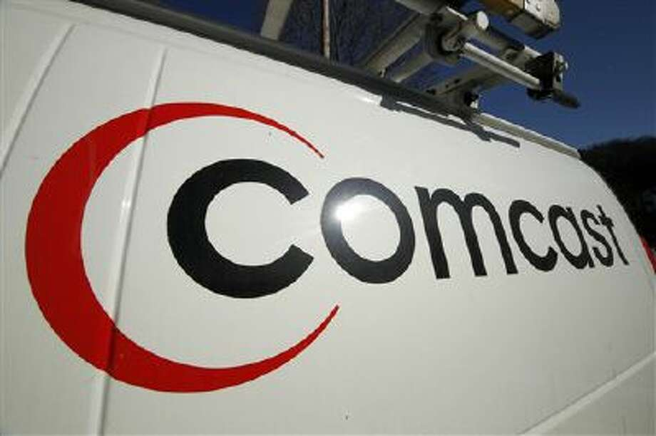 The Comcast logo is shown on one of the company's vehicles. Comcast has agreed to buy Time Warner Cable for $45.2 billion in stock in a deal that would combine the top two cable TV companies in the nation. Photo: ASSOCIATED PRESS / A2011