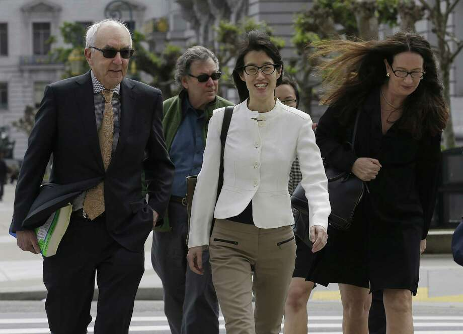 Ellen Pao, center, walks to Civic Center Courthouse in San Francisco, Friday, March 27, 2015. The jury are due back in court on Friday in Pao's lawsuit against Kleiner Perkins Caufield & Byers. Pao says the firm discriminated against her because she was a woman and then retaliated by denying her a promotion and firing her when she complained about gender bias. Kleiner Perkins denies the allegations. (AP Photo/Jeff Chiu) Photo: AP / AP