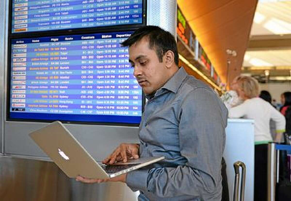 Amol Koldhekar, 23, who is a frequent business flyer and likes to use a website Flyertalk, to learn about all things travel. Best deals, best meals and frequent flyer miles are common topics. LAX Bradley Terminal check in area.