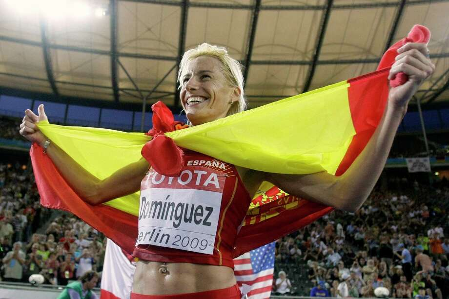 FILE - In this Monday, Aug. 17, 2009 file photo, Spain's Marta Dominguez celebrates after winning the gold medal in the Women's 3000m Steeplechase at the World Athletics Championships in Berlin. Former world champion runner Marta Dominguez has been banned for three years by the Court of Arbitration for Sport on Thursday, Nov. 19, 2015, and risks losing her 2009 steeplechase gold medal. CAS ruled after appeals by the IAAF and World Anti-Doping Agency challenging the Spanish athletics federation's decision last year to clear Dominguez of irregularities in her biological passport. Photo: AP Photo/Matt Dunham, FilE In This Aug. 17, 2009 Photo, Spain's Marta Dominguez Celebrates After  / AP