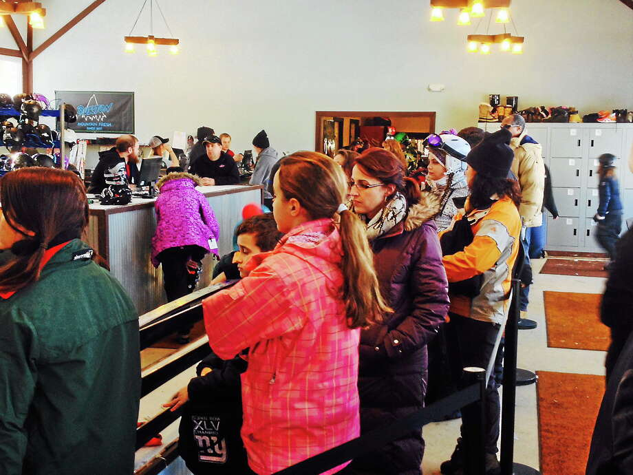 Customers wait in line to rent ski equipment at the Powder Ridge Ski Area Monday in Middlefield. Photo: Michael T. Lyle Jr. — The Middletown Press