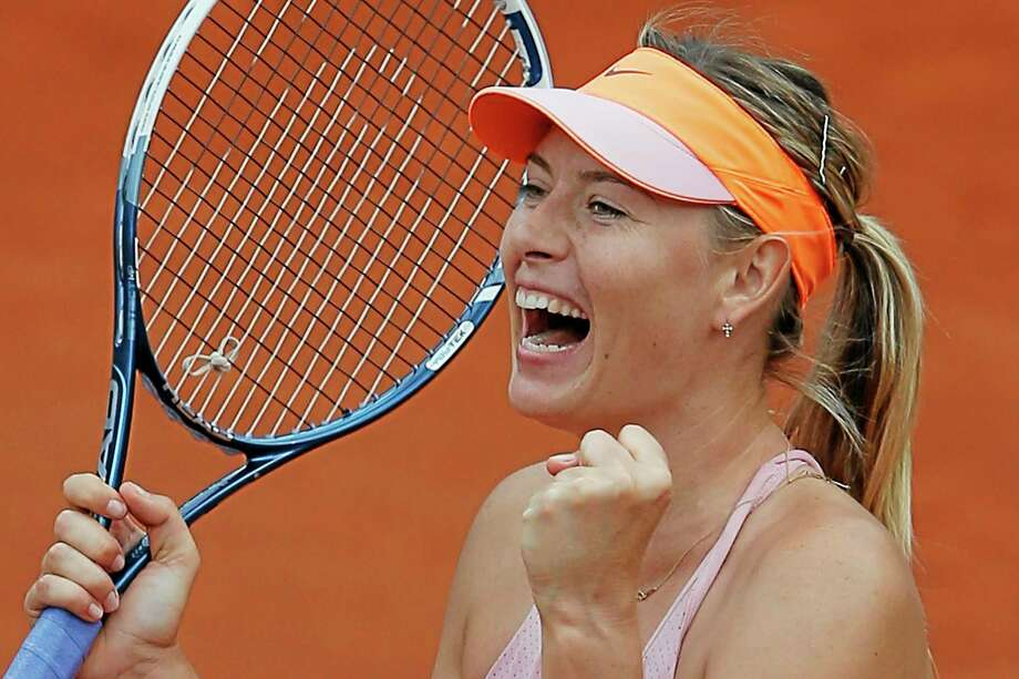Maria Sharapova beat Garbine Muguruza in the quarterfinals of the French Open at the Roland Garros stadium in Paris, on Tuesday. Sharapova won in three sets 1-6, 7-5, 6-1. Photo: Michel Spingler — The Associated Press  / AP