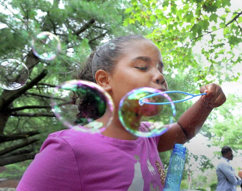 Savannah Morrobel, 9, of Greenwich, blew bubbles during the Family Centers Health Care Fair to celebrate National Health Center Week at Wilbur Peck Court in Greenwich, Conn., Saturday, Aug. 12, 2017.  According to Carter Ashforth of  Family Centers, the fair was held to publicize the Family Centers Health Care Clinic at Wilbur Peck Court that is open to the public Monday through Friday from  9 a.m. - 5 p.m. Photo: Bob Luckey Jr., Hearst Connecticut Media / Greenwich Time