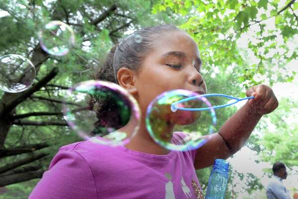 Savannah Morrobel, 9, of Greenwich, blew bubbles during the Family Centers Health Care Fair to celebrate National Health Center Week at Wilbur Peck Court in Greenwich, Conn., Saturday, Aug. 12, 2017.  According to Carter Ashforth of  Family Centers, the fair was held to publicize the Family Centers Health Care Clinic at Wilbur Peck Court that is open to the public Monday through Friday from  9 a.m. - 5 p.m.