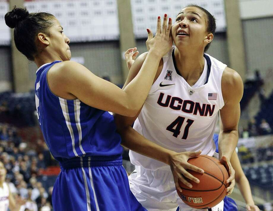 UConn's Kiah Stokes, right, looks to shoot as Creighton's Alexis Akin-Otiko defends during the second half of the No. 3 Huskies' 96-60 win on Sunday in Storrs. Photo: Jessica Hill — The Associated Press  / FR125654 AP