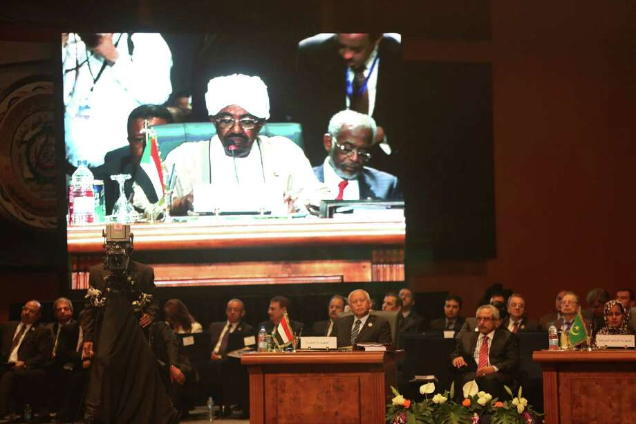 "Yemeni President Abdel Rabbo Mansour Hadi, center, attends a meeting of Arab heads of state as Sudanese President Omar al-Bashir speaks, in Sharm el Sheik, South Sinai, Egypt, Saturday, March 28, 2015. Yemen's embattled president on Saturday called Shiite rebels who forced him to flee the country ""stooges of Iran,"" directly blaming the Islamic Republic for the chaos there and demanding airstrikes against rebel positions continue until they surrender. Photo: (AP Photo/Thomas Hartwell) / AP"
