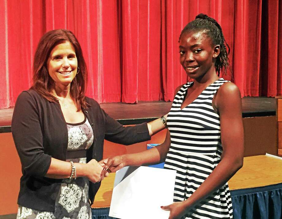 Middletown High School guidance counselor Stephanie Campbell presents senior Genevieve Arhin with the International Fraternal Order of the Oddfellows Scholarship at the annual MHS awards ceremony May 28. More than $90,000 in scholarships from private sources were given to nearly 60 students. Photo: Courtesy Middletown High School